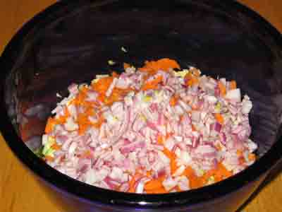 Adding onions to the greek cabbage salad.