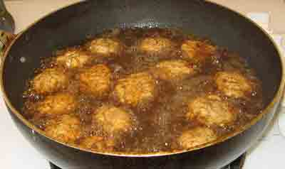 Frying the summer meatballs for greek recipe keftedes kalokairinoi