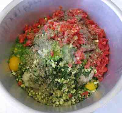 Mix ingredients well for greek recipe kalokairinoi summer meatballs.