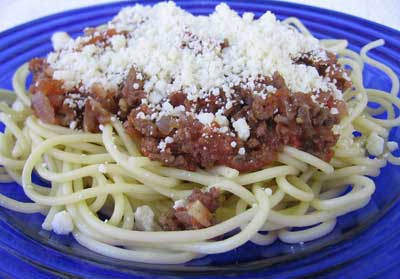 A serving of makaronia me kima, the greek recipe for spaghetti with meat sauce.