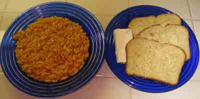 Orzo or manestra in tomato sauce with bread and feta.