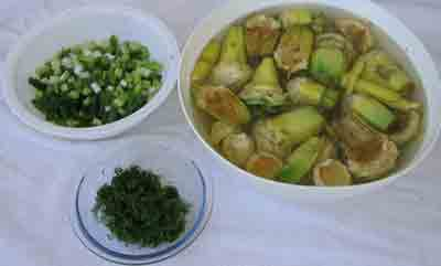 Artichokes, scallions and dill for beef wth artichokes moschari-me-agkinares