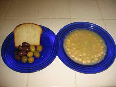 Revithia soup served with bread and olives.