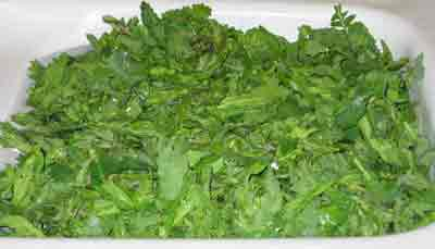 Mustard greens being washed for greek recipe vrouves.